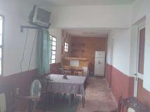 Apartamento de Elanis en zona de playa, vista de la sala a la cocina-comedor
